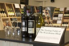The Tasting Table at our Warehouse Shop in Basingstoke, Hampshire. Photography by Joakim Blockstrom. Berry Bros, Tasting Table, Wine And Spirits, Hampshire, Warehouse, Berries, Drinks, Bottle, Photography