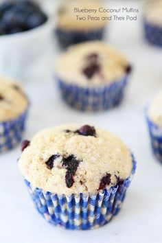 Blueberry Coconut Muffin Recipe on http://twopeasandtheirpod.com Made with coconut oil, coconut milk, and coconut!