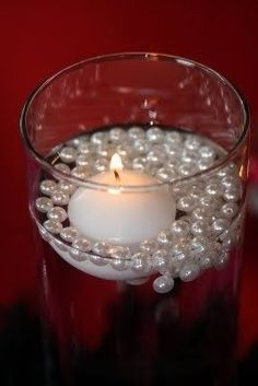 Candle  Pearls. Cute but simple. What about changing the color of the water???? :)