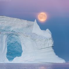 Sphinx - Full moon rising above Scoresby Sund in east Greenland. Panoramic photo (2 images) on 400 mm nikkor + d810. Expedition with Danielkordan.com