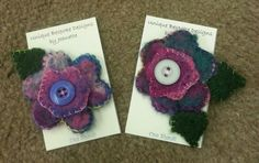 Two flower & leaf hand felted broaches, hand embroidered & embellished.