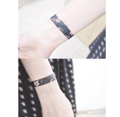 Black arm band tattoo @ Instagram