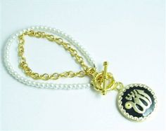 Our Allah name white faux pearls Islamic bracelet is refinement personified. This is definitely one of our favorite Allah bracelets! Handmade with beautiful pure white faux pearls and embellished with a gold plated chain and a heart shaped toggle clasp, this bracelet will too become one of your favorite pieces to wear!  Price: $35.99 #allahbracelet #islamicbracelet #muslimjewelry #allahcharmbracelet #arabicbracelet #arabicjewelry #allahloversjewelry