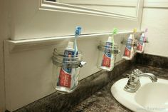 Great use of mason jars to keep the bathroom neat and not pass those germs!!!-- maybe not mason jars, but love the idea of this- and not having clutter on the counter!