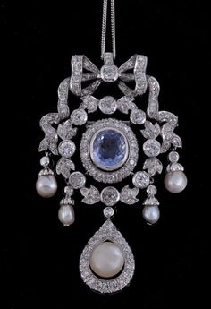 A Beautiful Belle Epoque Blue Sapphire, Diamond, and Pearl Pendant with top bow.