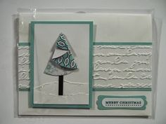 Card made with a folded paper Christmas Tree and Prett Print embossing folder.