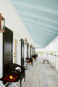 Light blue porch ceiling, glossy black shutters