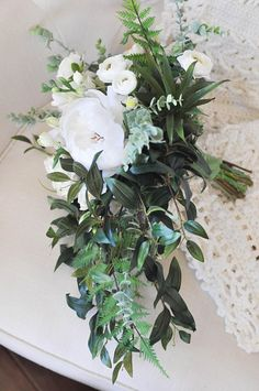 A timeless, cascading bouquet that suits every style! It features ivory flowers and soft green succulents to compliment the lush, flowing foliage. Plus its engineered to be light yet durable, so it will stay comfortable in your hands all day long!  Measurements: about 15 tall, about