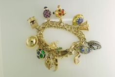 14K Yellow Gold Bracelet With 18K, 14K, 9K, Sterling Silver and Other Charms