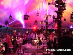 Great tented wedding with lanterns and light by Perona Farms