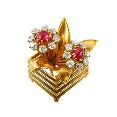 1940s Mauboussin Ruby Diamond Gold Basket Brooch. An 18 kt gold diamond and ruby basket brooch. Mauboussin, Paris, 1940 c.a.