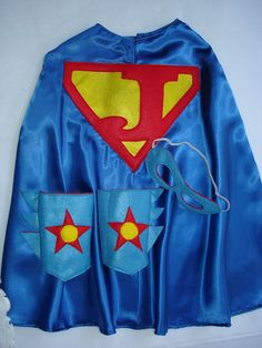 Children's Custom Superhero Personalized Kids Cape Including Matching Mask, and Wrist Cuffs. $32.50, via Etsy.