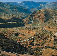 Salt River Canyon in Arizona -- the road goes right through it.  A gorgeous drive!