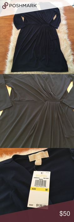 Beautiful navy blue Michael kors dress NWT Beautiful navy blue dress. Brand new with tags. Beautiful gathering details. Navy color makes it perfect for any season! 1/2 or 3/4 sleeves. Michael Kors Dresses Midi