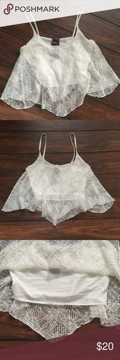 Lace Crop Top Fully lined crop top tank with pretty loose lace overlay. Perfect for festival season. Like new condition. Size large, but fits more like a medium. Moon Collection Tops Crop Tops
