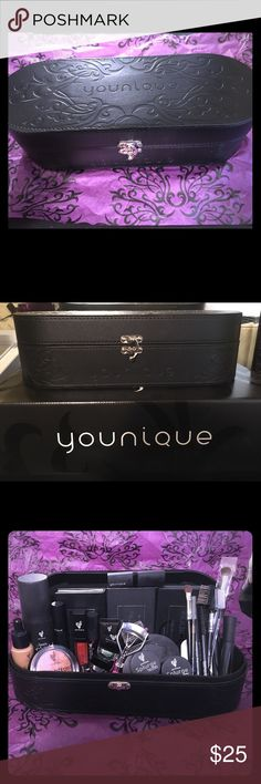 "🎁Black younique makeup tote embossed with vines🎁 🎁 FREE mystery gifts inside this younique tote!! This is a brand new black ""younique"" make up tote. This exterior is embossed with ""younique"" on the front and also embossed with the younique flower vines. It closes with a metal loop clasp. This tote is only available to ""younique"" presenters. I have two so I am selling this one. It can fit a quite a bit of make up. The make up is not included in this sale. Make up will be sold separately…"