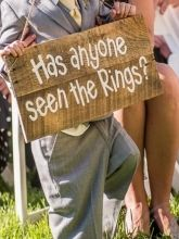 "Remember cody will only be 2. So I'm guessing it can't be heavy   ""Has anyone seen the rings?"" Sign for the Ring bearer"