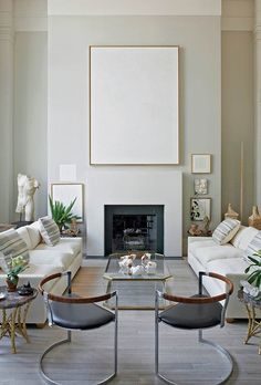 A true tabula rasa in minimal brass frame. Interior design by Daniel Romualdez