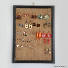 Create an earring holder out of a picture frame and burlap bag! No more lost earrings!