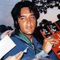 Elvis came down to the gates of Graceland to sign autographs and pose for pictures. 5-29-69