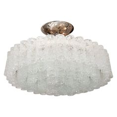 Nickel tiered chandelier composed of cylindrical icy glass elements by Doria.