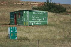 I love this picture on so many levels. Rural South Africa and this person used geographical motorist signs to construct the walls of his home. It reminds me of a South African saying 'Oos, wes, tuis bes' (East, west, home best) Funny Road Signs, South Afrika, Out Of Africa, Thing 1, My Land, Home Signs, Pretoria, Cape Town, Making Out