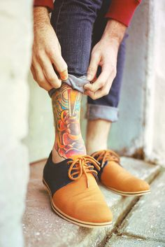 Great tats. And I love the way he rolls up the jeans to share the artwork. Very stylish guy.  Biddy Craft