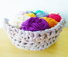 Crochet basket pattern, made out of t-shirt yarn - I just cut up tons of LaJoya shirts for another quilt so this is perfect for the leftovers.