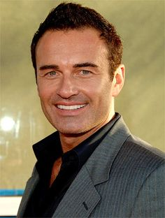 "Julian McMahon. - One of the most handsome actors working.  He's a real throwback to the old Hollywood ""matinee idol"" good looks."