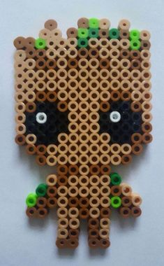 Baby Groot made from perler beads - Easy Crafts for All Easy Perler Bead Patterns, Melty Bead Patterns, Perler Bead Templates, Diy Perler Beads, Perler Bead Art, Beading Patterns, Loom Patterns, Jewelry Patterns, Embroidery Patterns
