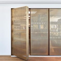 Loving this door-like beverage storage solution in perforated brass. Design by… Interior Architecture, Interior Design, Wine Display, Door Design, House Design, Storage Design, Wine Storage, Commercial Interiors, Office Interiors