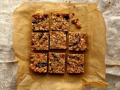 Date and Oat Squares with Sesame Seeds 2½ cups regular rolled oats  ½ cup toasted almonds, chopped  6 tablespoons toasted un-hulled sesame seeds, plus more to sprinkle on top  8 Medjool dates, thinly sliced  ½ cup brown rice syrup  1 tablespoon extra virgin coconut oil, plus more to oil sides of pan  3 tablespoons raw cashew butter  2 tablespoons tahini  ¼ teaspoon salt  1 tablespoon pure vanilla extract  Zest of one orange