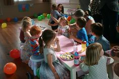 Small tables and stools enable pre-schoolers to enjoy a party without falling off adult chairs - simple and obvious you'd think