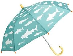 A shark umbrella is perfect for the rainy days at the beach during #SharkWeek.