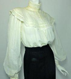 Winter white cotton Gibson Girl early 1900s blouse with high collar and rounded lace upper bodice. Buttons up back with tiny mother of pearl buttons.