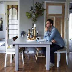 SIGURD chair £40 White. 802.011.46 STORNÄS dining table £225 147/204x95cm. Grey-brown. 201.840.84 'Lighting is easily overlooked as a way to update a room, yet it's so flexible. Add candles, change lampshades… at the moment I'm loving the industrial look of exposed bulbs over our table.'