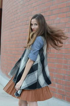 Under plad vest with brown pleated skirt