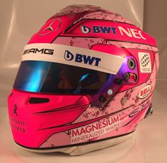 Esteban Ocon unveils new helmet. (His is the one on the left).
