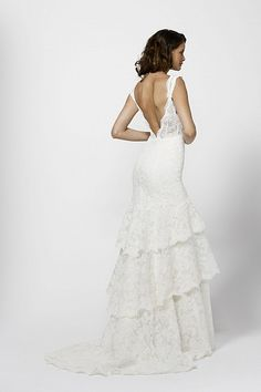 Ivory lace tiered v-neck dress over a double layer of ivory silk stretch charmeuse detachable slip dress. Sweep train.