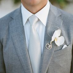 White Orchid Boutonniere. For the men with gold ribbon.
