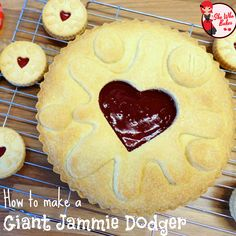 Giant Jammie Dodger - She Who Bakes. Could easily be made vegan by using a vegan baking spread instead of butter - after all, the original Jammy Dodgers are vegan!