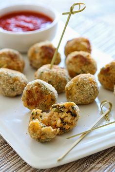 Bite sized Italian rice balls made with brown rice, spinach, chicken sausage and cheese, breaded and baked in the oven. Served with Marinara for dipping – so good!
