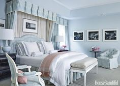 The master bedroom in a Beverly Hills home by Mary McDonald is enveloped in a soothing sky blue. Bedding, Schweitzer Linen. Custom headboard. Lamp, Keramis. Bench upholstered in a Carleton V fabric.