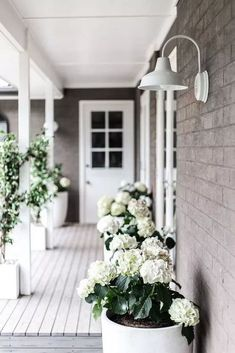 front porch planting 47 Rustic Farmhouse Porch Decorating Ideas to Show Off This Season House With Porch, House Front, Barn Lighting, Outdoor Lighting, Outdoor Farmhouse Lighting, Pergola Lighting, Lighting Store, Lighting Ideas, Lighting Design