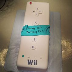 Wii remote control gamer video game cake 13th birthday boy. Hand cut all the pieces.