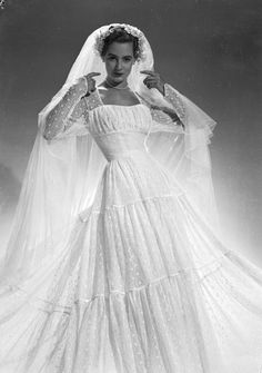 36 Stunning Vintage Wedding Dresses From Yesteryear  1951-A flowing wedding dress by Mercia, with lace sleeves.