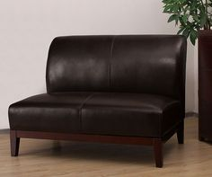Supplement a sitting area with this dark-brown leather loveseat, a transitional piece that works in traditional and modern homes. The wooden legs and base are stained dark to match and the comfortable, upholstered seat accommodates a pair of friends.
