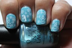 """Let it snow, Let it snow, Let it snow"" by Rin's Nail Files. ""I started off with OPI What's with the Cattitude and then added OPI Dominant Jeans for some shimmer. I used white Konad polish with plate T37 for snowflakes and snowman and D02 for the snowman with tree."""