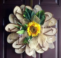 Eight pairs of rattan like flip flops trimmed in gold,silver and bronze colored trim make this wreath a welcome addition to your door or Flip Flop Wreaths, Wreaths For Front Door, Door Wreaths, Wreath Crafts, Diy Wreath, Upholstery Pins, Diy Craft Projects, Diy Crafts, Flip Flop Craft