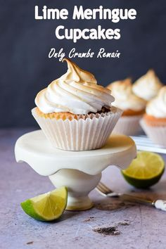 Inspired by the classic lemon meringue pie, these lime curd meringue cupcakes are filled with homemade lime curd and topped with Italian Meringue. A retro dessert with a new twist. #onlycrumbsremain #meringuecupcakes #limecupcakes Cream Filled Cupcakes, Lime Cupcakes, Baking Cupcakes, Yummy Cupcakes, Cupcake Recipes, Baking Recipes, Cupcake Cakes, Dessert Recipes, Fruit Recipes